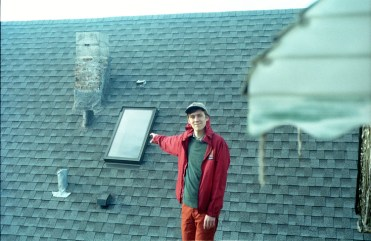 Spencer Radcliffe on roof top in Chicago. Taken from Run For Cover Records web site.