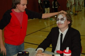 Students participating in the face painting event.