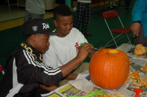 Two students planning their design for their pumpkin.