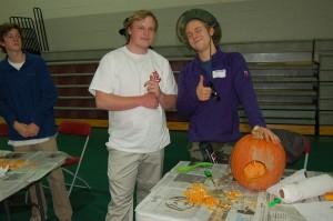 Seniors displaying their creative pumpkin design.